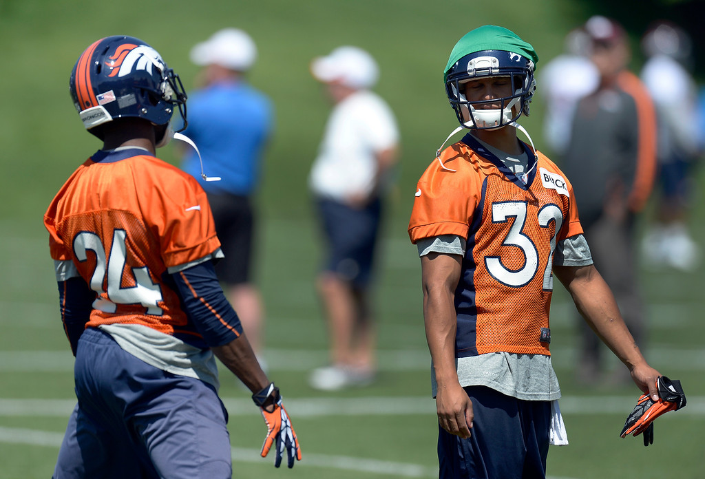 . Champ Bailey (24) of the Denver Broncos chats with Tony Carter (32) during mini camp June 11, 2013 at Dove Valley. (Photo By John Leyba/The Denver Post)