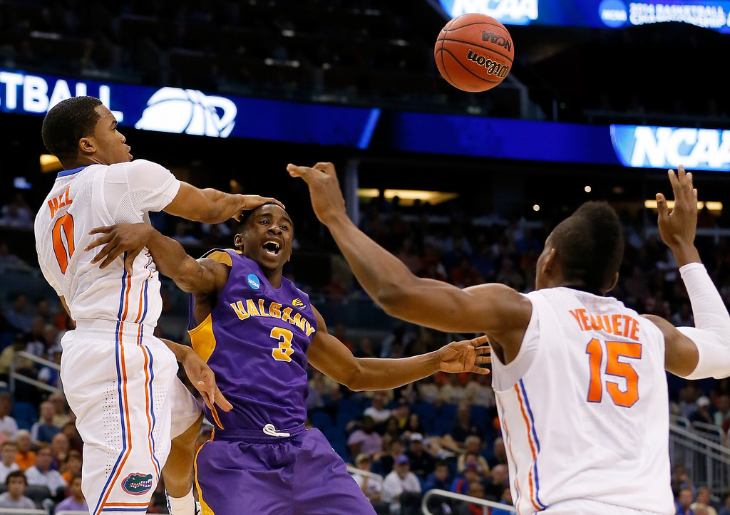 . ORLANDO, FL - MARCH 20:  DJ Evans #3 of the Albany Great Danes goes up for a shot against Kasey Hill #0 of the Florida Gators in the second half during the second round of the 2014 NCAA Men\'s Basketball Tournament at Amway Center on March 20, 2014 in Orlando, Florida.  (Photo by Kevin C. Cox/Getty Images)