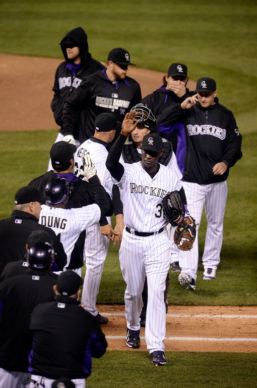 . DENVER, CO - APRIL 5:  Colorado closer LaTroy Hawkins (32) celebrated the win with the team Saturday night. The Colorado Rockies defeated the Arizona Diamondbacks 9-4 Saturday night, April 5, 2014 in Denver. (Photo by Karl Gehring/The Denver Post)