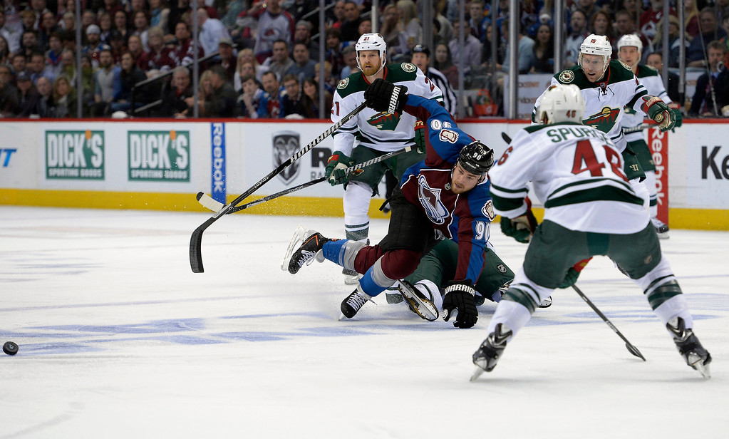 . DENVER, CO - APRIL 26: Colorado Avalanche center Ryan O\'Reilly (90) gets tripped up with Minnesota Wild defenseman Clayton Stoner (4) during the first period of action. The Colorado Avalanche hosted the Minnesota Wild in the fifth round of the Stanley Cup Playoffs at the Pepsi Center in Denver, Colorado on Saturday, April 26, 2014. (Photo by John Leyba/The Denver Post)