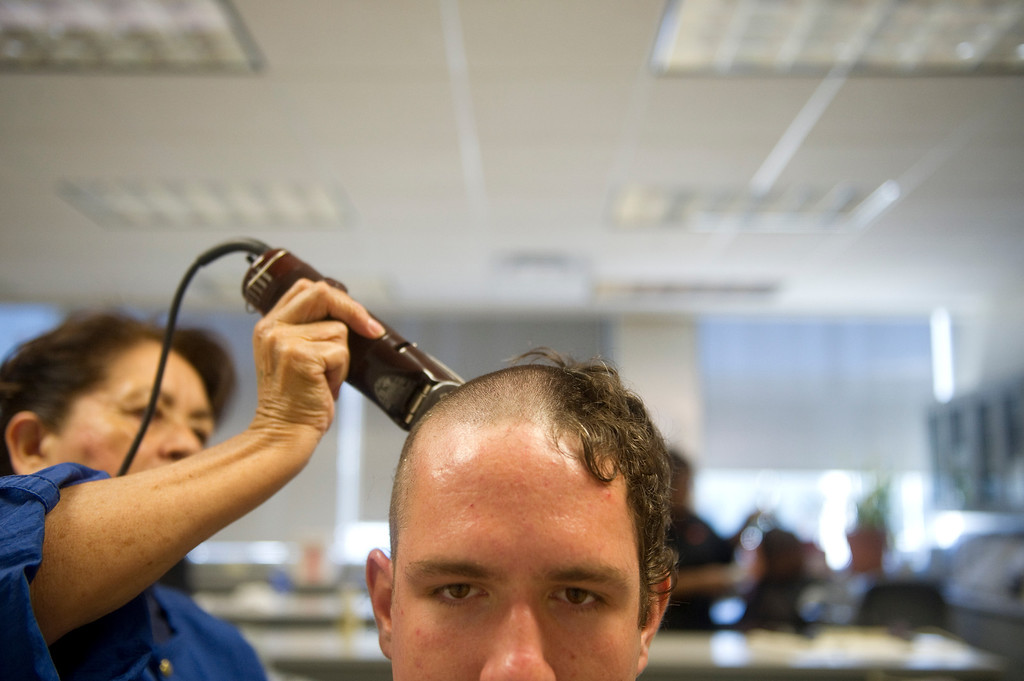 . COLORADO SPRINGS, CO. - JUNE 27: Basic Cadet Trainee Allen Caunitz has his hair buzzed off during inprocessing of the class of 2017 at the Air Force Academy on June 27, 2013. Nearly 1000 trainees were processed on Thursday.(Photo By Grant Hindsley/The Denver Post)