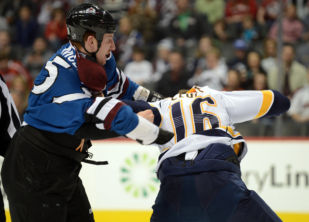 . Cody McLeod of Colorado Avalanche (#55), left, and Rich Clune of Nashville Predators (#16) fighting in the 1st period of the game at Pepsi Center. Denver, Colorado. March 30, 2013. (Photo By Hyoung Chang/The Denver Post)