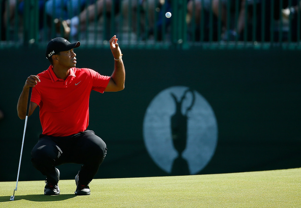 . Tiger Woods of the United States catches his ball on the 2nd green during the final round of The 143rd Open Championship at Royal Liverpool on July 20, 2014 in Hoylake, England.  (Photo by Tom Pennington/Getty Images)