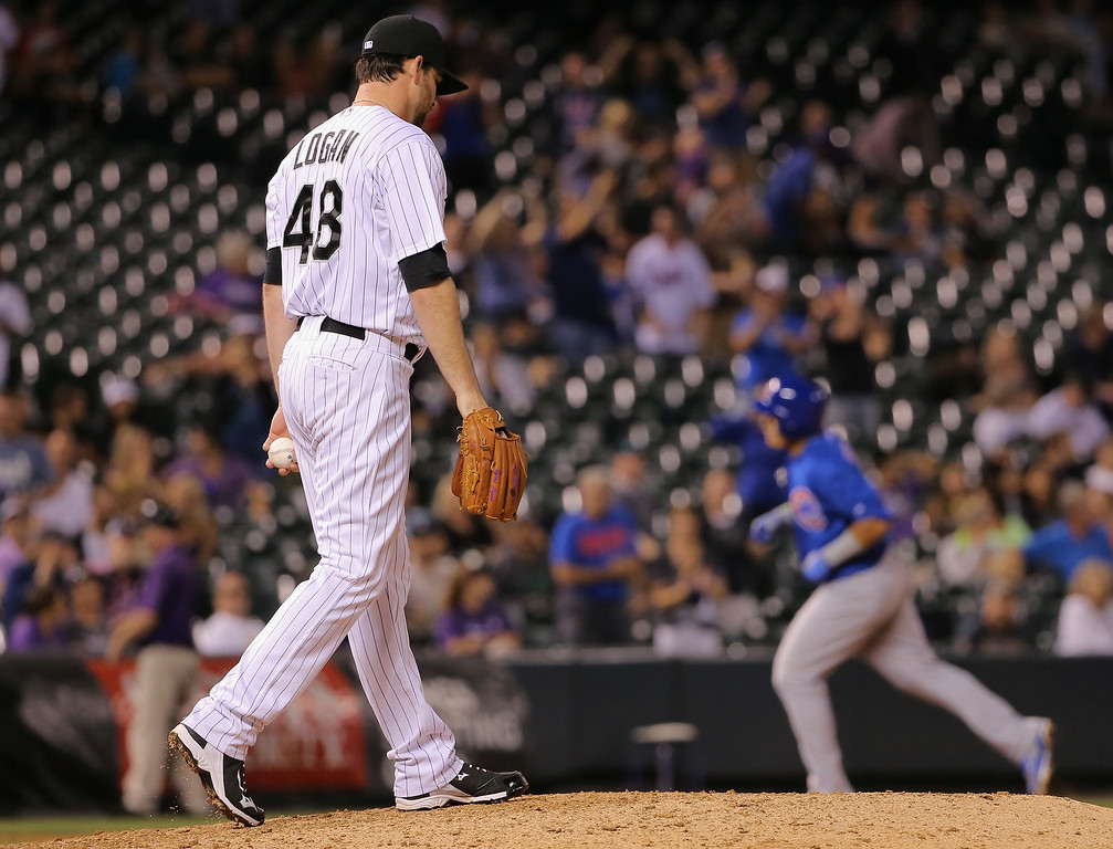 . DENVER, CO - AUGUST 05:  Boone Logan #48 of the Colorado Rockies returns the mound after giving up the game winning home run to Javier Baez #9 of the Chicago Cubs in the 12th inning at Coors Field on August 5, 2014 in Denver, Colorado. The Cubs defeated the Rockies 6-5.  (Photo by Doug Pensinger/Getty Images)