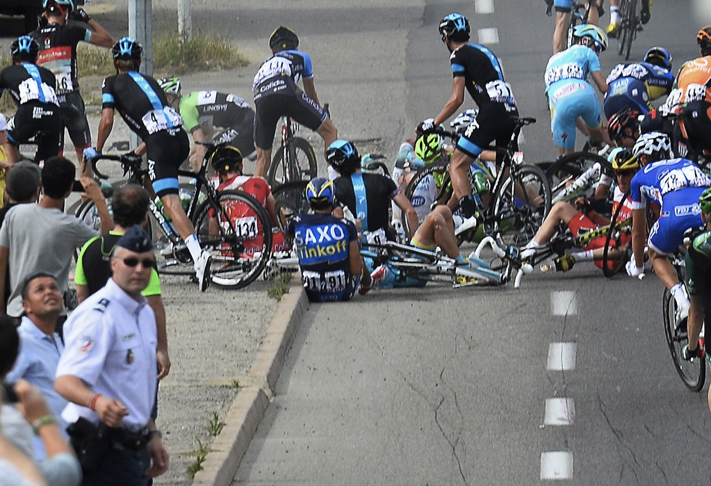 . Alberto Contador of Spain, center with number 91, sits on the road after a group of riders crashed during the first stage of the Tour de France cycling race over 213 kilometers (133 miles) with start in Porto Vecchio and finish in Bastia, Corsica island, France, Saturday June 29, 2013. AFP PHOTO / POOL / Stephane Mantey/AFP/Getty Images