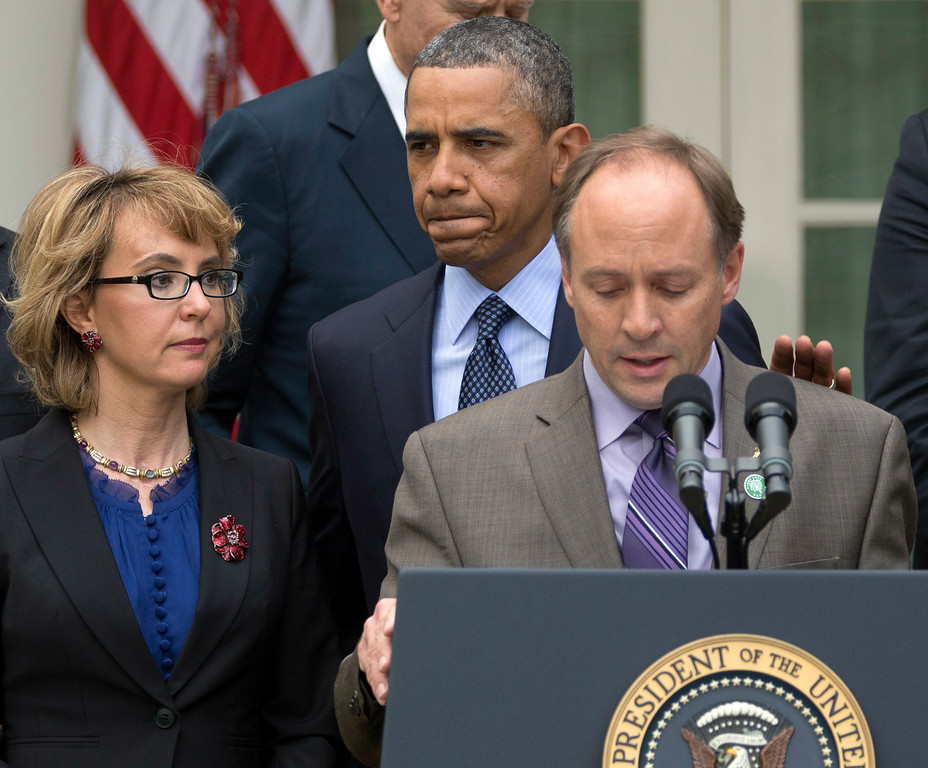 . President Barack Obama arrives to participate in a news conference in the Rose Garden of the White House, Wednesday, April 17, 2013, in Washington, about measures to reduce gun violence. With tObama is former Rep. Gabby Giffords, left, and Mark Barden, the father of Newtown shooting victim Daniel.  (AP Photo/Carolyn Kaster)