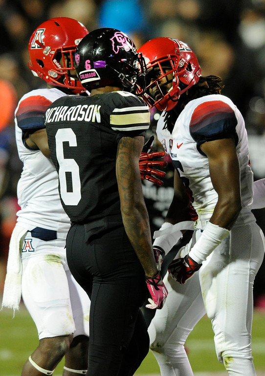 . BOULDER, CO. - OCTOBER 26: CU receiver Paul Richardson was separated from Arizona cornerback Jonathan McKnight as they shared words in the first half. The University of Colorado football team hosted Arizona Saturday night, October 26, 2013. Photo By Karl Gehring/The Denver Post