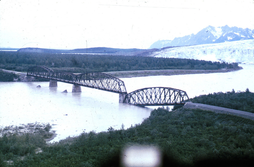 . Alaska Earthquake March 27, 1964. One span of the Million Dollar truss bridge of the former Copper River and Northwestern Railroad was dropped into the Copper River by the earthquake, and the other truss spans were shifted on their piers. U.S. Geological Survey photo