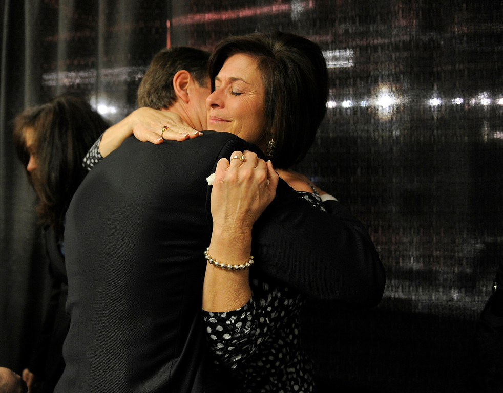 . DENVER, CO. - APRIL 2: Former DU hockey coach George Gwozdecky gives a hug to his wife Bonnie after a news conference April 2, 2013 at Magnuss Arena. Gwozdecky was on hand to discuss the school firing him on Monday. This ends his Pioneers coaching tenure at 19 seasons. (Photo By John Leyba/The Denver Post)