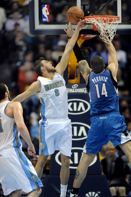 . Denver forward Danilo Gallinari (8) tried to block a shot from Wolves center Nikola Pekovic (14) in the second half. The Minnesota Timberwolves took a bite out of the Denver Nuggets winning 101-97 at the Pepsi Center Thursday night, January 3, 2013. Karl Gehring/The Denver Post