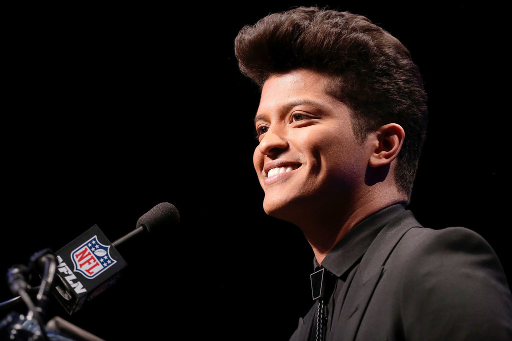 . Bruno Mars who will headline the half-time show at the NFL Super Bowl XLVIII football game speaks during a press conference Thursday, Jan. 30, 2014, in New York. (AP Photo/Charlie Riedel)