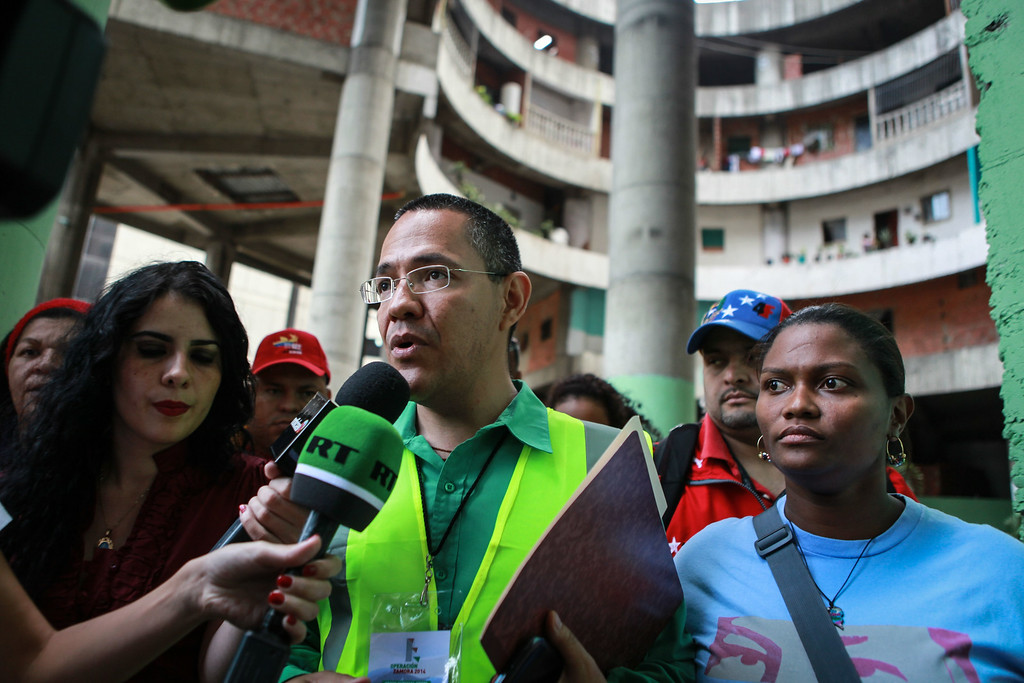 . The Minister of State for the Urban Transformation of Greater Caracas, Ernesto Villegas, speaks to the press during the eviction of the Tower of David, an abandoned skyscraper in Caracas originally intended to be an office building that became a \'vertical slum\', on July 22, 2014. The government began the eviction and relocation of hundreds of families that were illegally occupying the building. FEDERICO PARRA/AFP/Getty Images