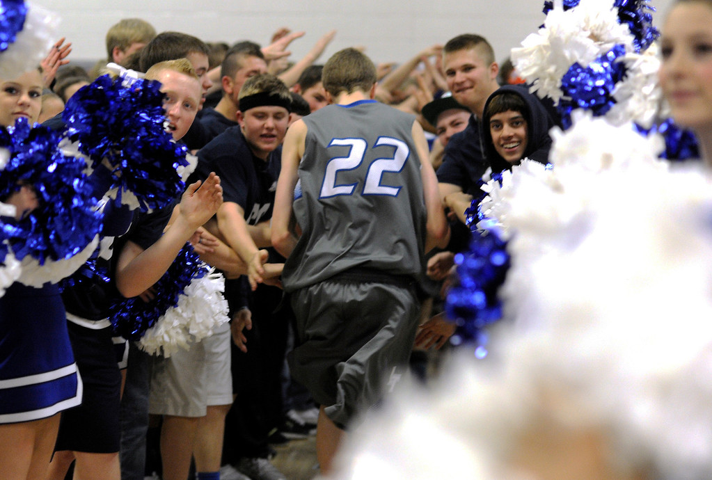 . LITTLETON, CO. - MARCH 6: Legend guard Taylor Jensen (22) exited the court through a sea of fans after the win Wednesday. Jensen had two key free-throws at the end of the game.  The Legend High School boy\'s basketball team upset Chatfield 51-49  in a playoff game Wednesday night, March 6, 2013. (Photo By Karl Gehring/The Denver Post)