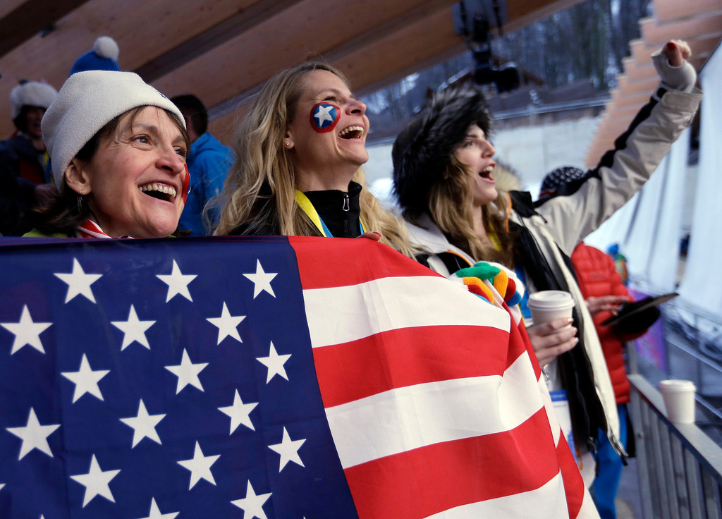 . Fans wait for the start of the men\'s singles luge final at the 2014 Winter Olympics, Sunday, Feb. 9, 2014, in Krasnaya Polyana, Russia. (AP Photo/Natacha Pisarenko)
