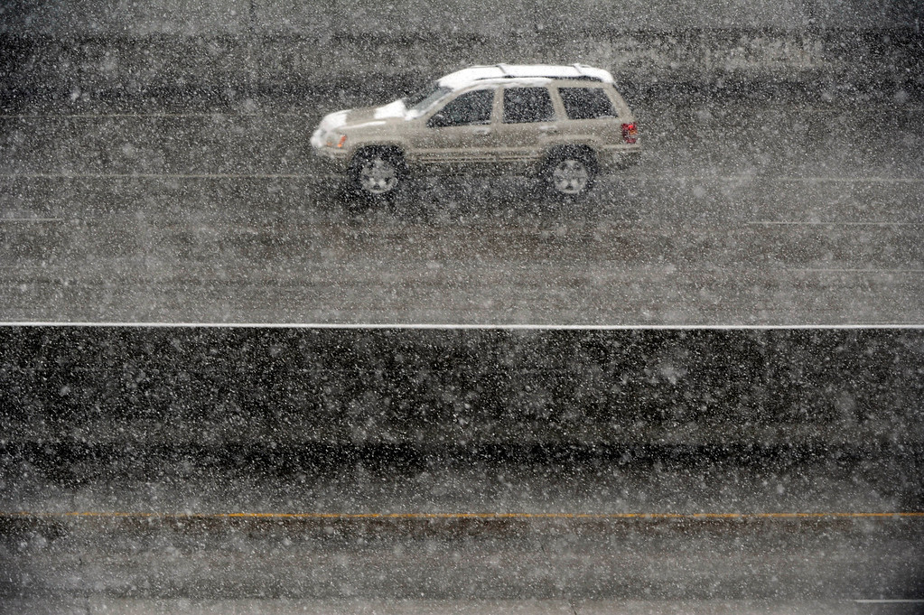 . DENVER, CO. - MARCH 9TH: A vehicle makes drives through steady snowfall northbound I-25 near the University of Denver Saturday morning, March 9th, 2013. (Photo By Andy Cross/The Denver Post)