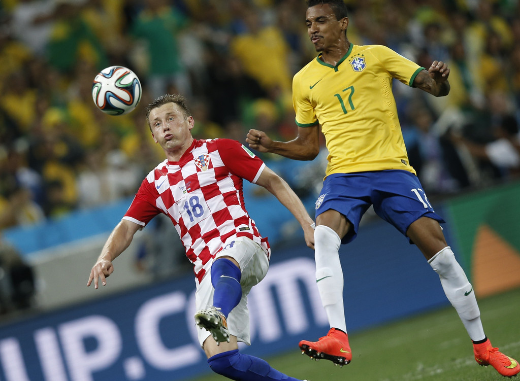 . Croatia\'s forward Ivica Olic (L) and Brazil\'s midfielder Luiz Gustavo vie for the ball during a Group A football match between Brazil and Croatia at the Corinthians Arena in Sao Paulo during the 2014 FIFA World Cup on June 12, 2014. AFP PHOTO / ADRIAN DENNIS/AFP/Getty Images