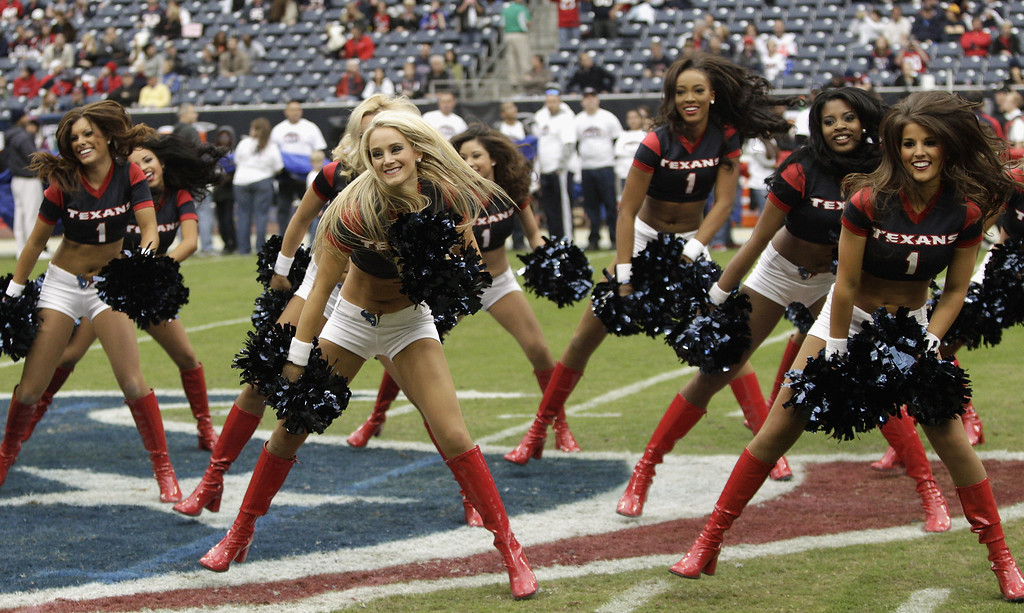 . Houston Texans cheerleaders perform during  a game against the Jacksonville Jaguars at Reliant Stadium on November 24, 2013 in Houston, Texas.  (Photo by Bob Levey/Getty Images)