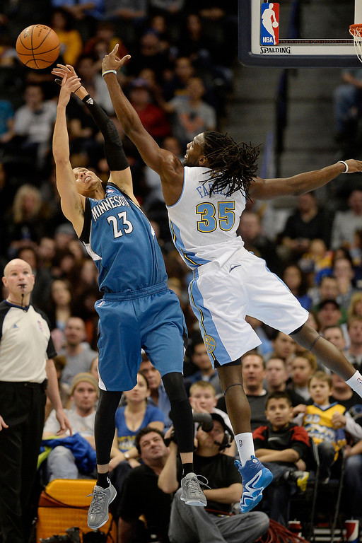 . Kenneth Faried (35) of the Denver Nuggets swats a rebound away from Kevin Martin (23) of the Minnesota Timberwolves during the second half of the Timberwolves\' 132-128 win. (Photo By AAron Ontiveroz/The Denver Post)