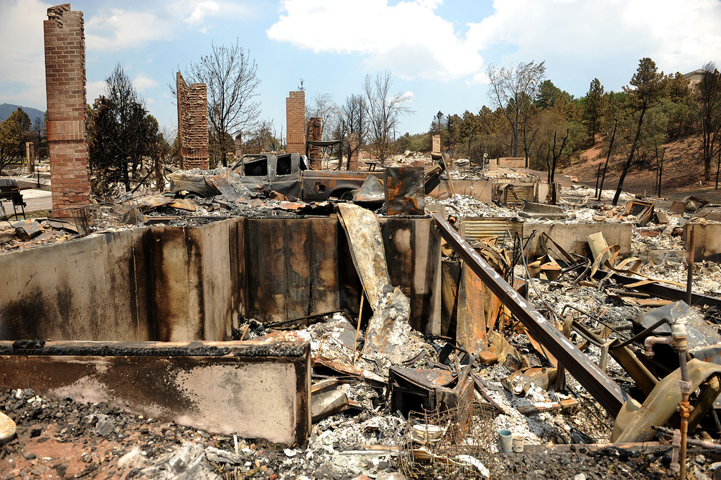 . Remnants of the wrath of the Waldo Canyon fire are more than evident in the Shadow Mountains subdivision on July 1, 2012.  Houses were burned completely to the ground while others survived the blaze. Helen H. Richardson, The Denver Post