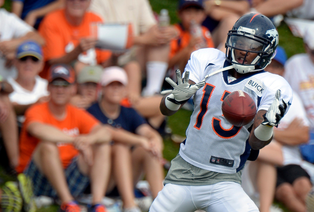 . Denver Broncos WR Kemonte Bateman (13) catches a pass during training camp August 1, 2013 at Dove Valley. (Photo By John Leyba/The Denver Post)