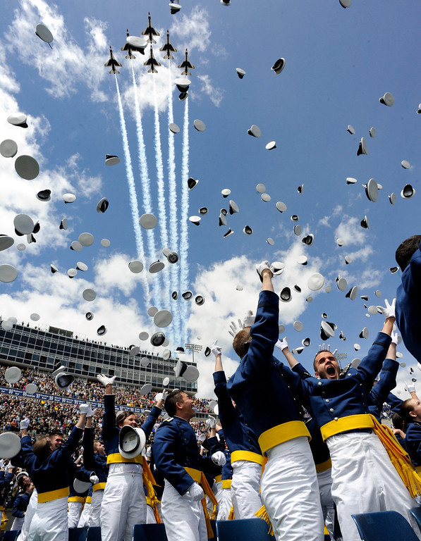 ". Air Force Cadets ""Dismissed\"" as the Air Force Thunderbirds fly over the United States Air Force Academy 53rd Graduation, Wednesday May 25th, 2011 at Falcon Stadium.  Andy Cross/The Denver Post"