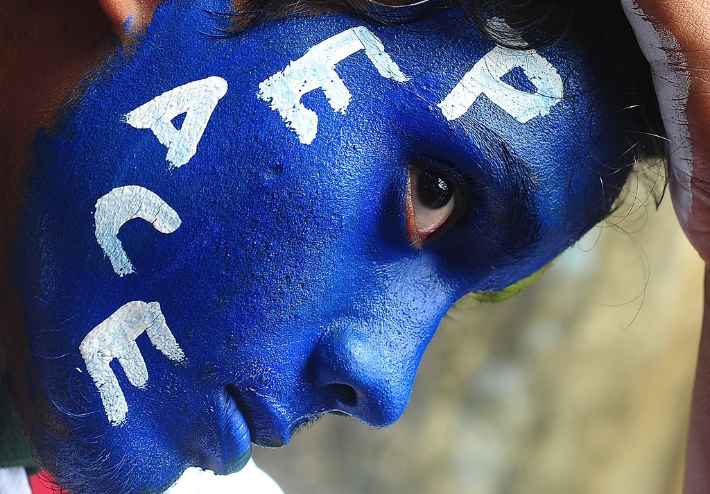. An Indian youth, his face painted with a peace message, takes part in a rally to mark Hiroshima Day in Mumbai on August 6, 2013, to mourn victims of the atomic bombing of Hiroshima in 1945. Peace rallies and memorial services the world over marked the world\'s first nuclear attack on Hiroshima - the moment 68 years ago when a single US bomb instantly killed more than 140,000 people and fatally injured tens of thousands of others with radiation or horrific burns. AFP PHOTO/Indranil  MUKHERJEE/AFP/Getty Images