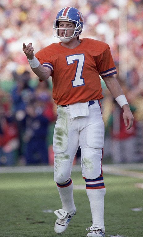 . Denver Broncos quarterback John Elway reacts after he was sacked in first half of Super Bowl XXII with the Washington Redskins, Sunday, Jan. 31, 1988 in San Diego. (AP Photo/Elise Amendola)