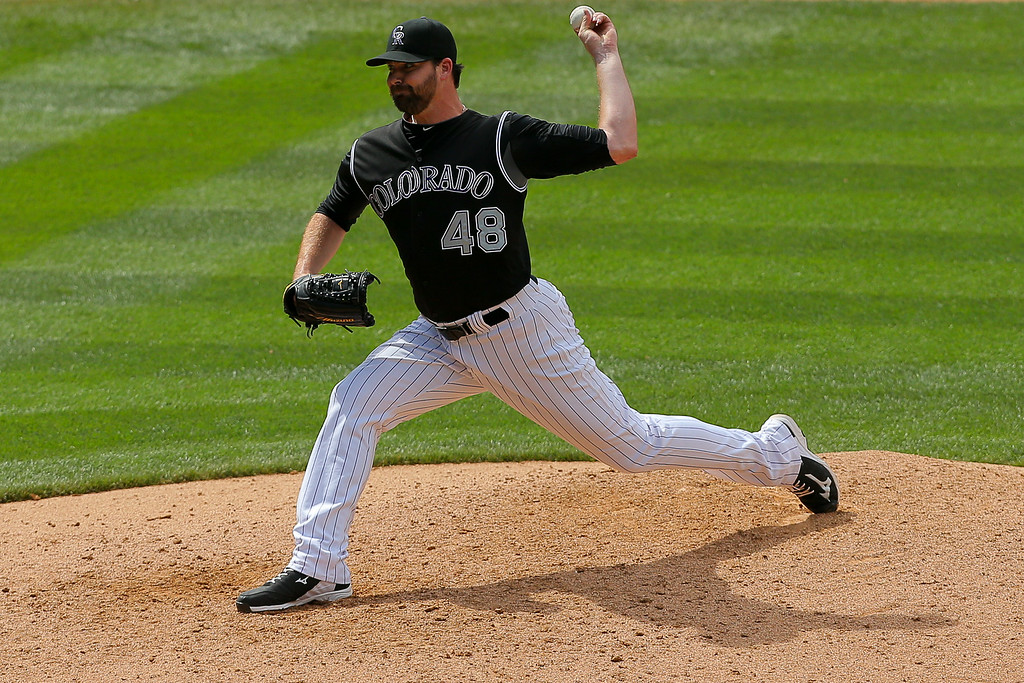. DENVER, CO - JULY 9:  Relief pitcher Boone Logan #48 of the Colorado Rockies delivers to home plate during the eighth inning against the San Diego Padres at Coors Field on July 9, 2014 in Denver, Colorado. (Photo by Justin Edmonds/Getty Images)