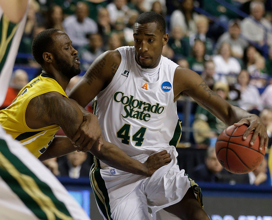 . Colorado State forward Greg Smith (44) drives against Missouri guard Keion Bell (5) during the first half  their second-round NCAA college basketball tournament game on Thursday, March 21, 2013, in Lexington, Ky. (AP Photo/John Bazemore)