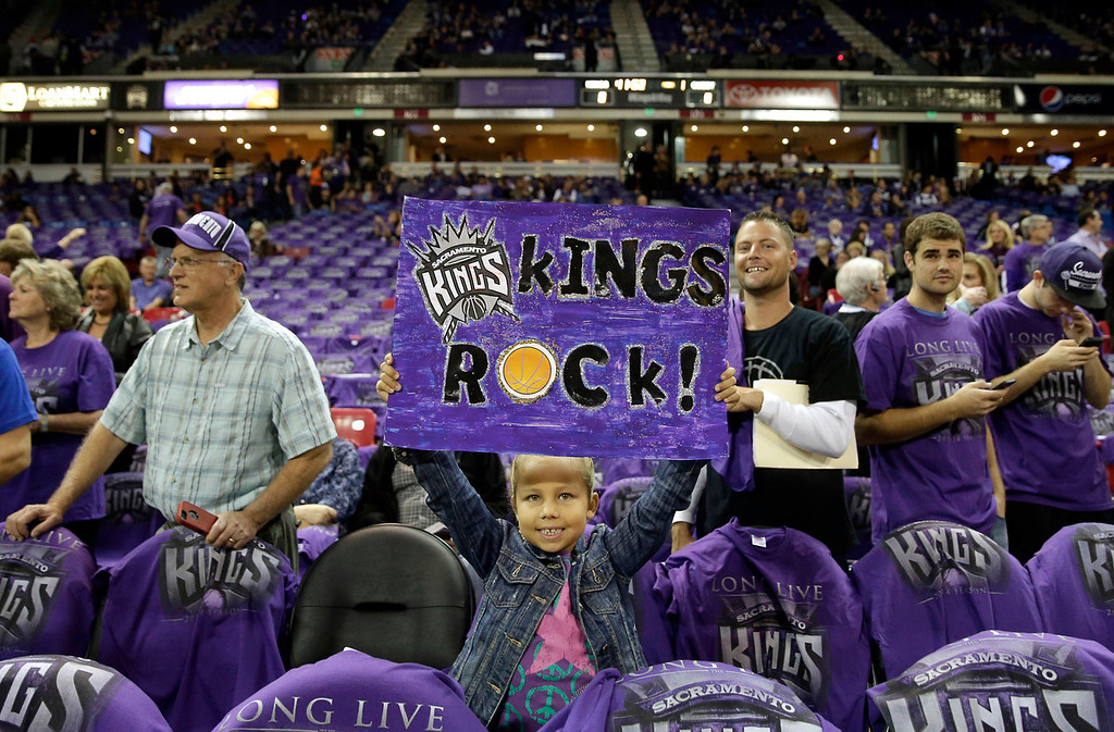 . Madelyn Jones, 7, shows her support for the Sacramento Kings before the home opening NBA basketball game against the Denver Nuggets in Sacramento, Calif., Wednesday, Oct. 30, 2013.(AP Photo/Rich Pedroncelli)