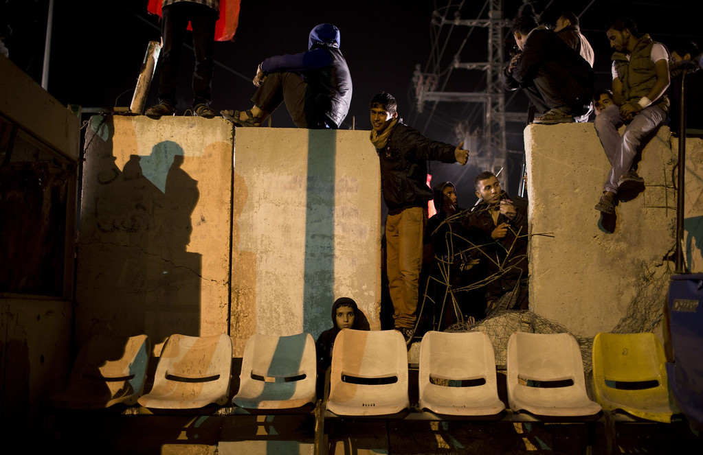 . Palestinian prisoners\' relatives wait for their release at Erez point in the northern Gaza Strip on October 29, 2013. Israel was preparing on October 29, 2013 to release 26 long-serving Palestinian prisoners, the second batch of 104 inmates who are to be freed in line with commitments to US-brokered peace talks. The release, due to take place late at night, will see 21 prisoners going to their homes in the West Bank.  MAHMUD HAMS/AFP/Getty Images
