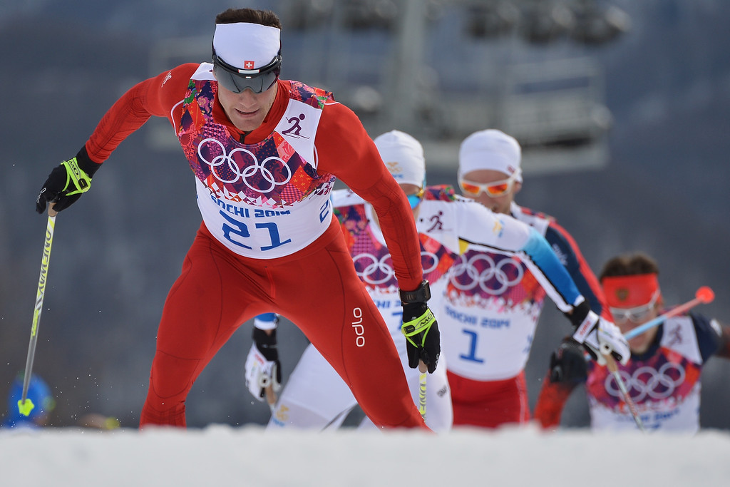 . Switzerland\'s Dario Cologna is chased by Sweden\'s Marcus Hellner (11) and Norway\'s Martin Johnsrud Sundby (1) as they compete in the Men\'s Cross-Country Skiing 15km + 15km Skiathlon at the Laura Cross-Country Ski and Biathlon Center during the Sochi Winter Olympics on February 9, 2014, in Rosa Khutor. Cologna snatched the gold medal, Hellner silver and Sundby bronze.  ALBERTO PIZZOLI/AFP/Getty Images