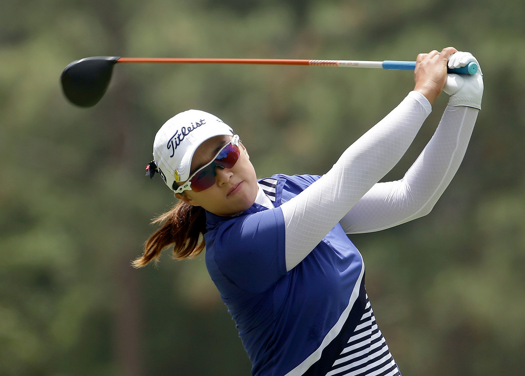 . Amy Yang watches her tee shot on the second hole during the final round of the U.S. Women\'s Open golf tournament in Pinehurst, N.C., Sunday, June 22, 2014. (AP Photo/Chuck Burton)