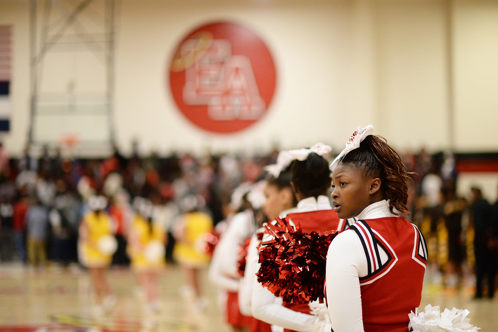 . DENVER, CO. JANUARY 24: Jayana Crowley, 17, of East High School cheers on the boys basketball team during the game against Thomas Jefferson High School at East High School in Denver, Colorado January 24, 2014. East High School won 91-62. (Photo by Hyoung Chang/The Denver Post)