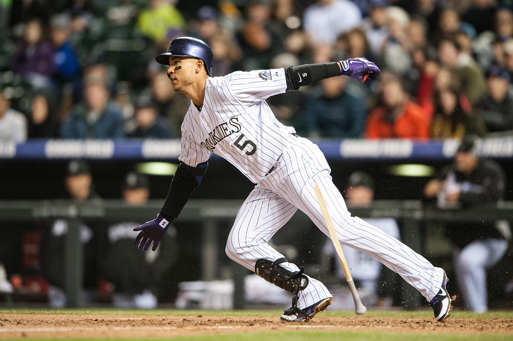. DENVER, CO - APRIL 20:  Carlos Gonzalez #5 of the Colorado Rockies breaks his bat and reaches on a fielding error in the seventh inning of a game against the Arizona Diamondbacks at Coors Field on April 20, 2013 in Denver, Colorado. The Rockies beat the Diamondbacks 4-3. (Photo by Dustin Bradford/Getty Images)