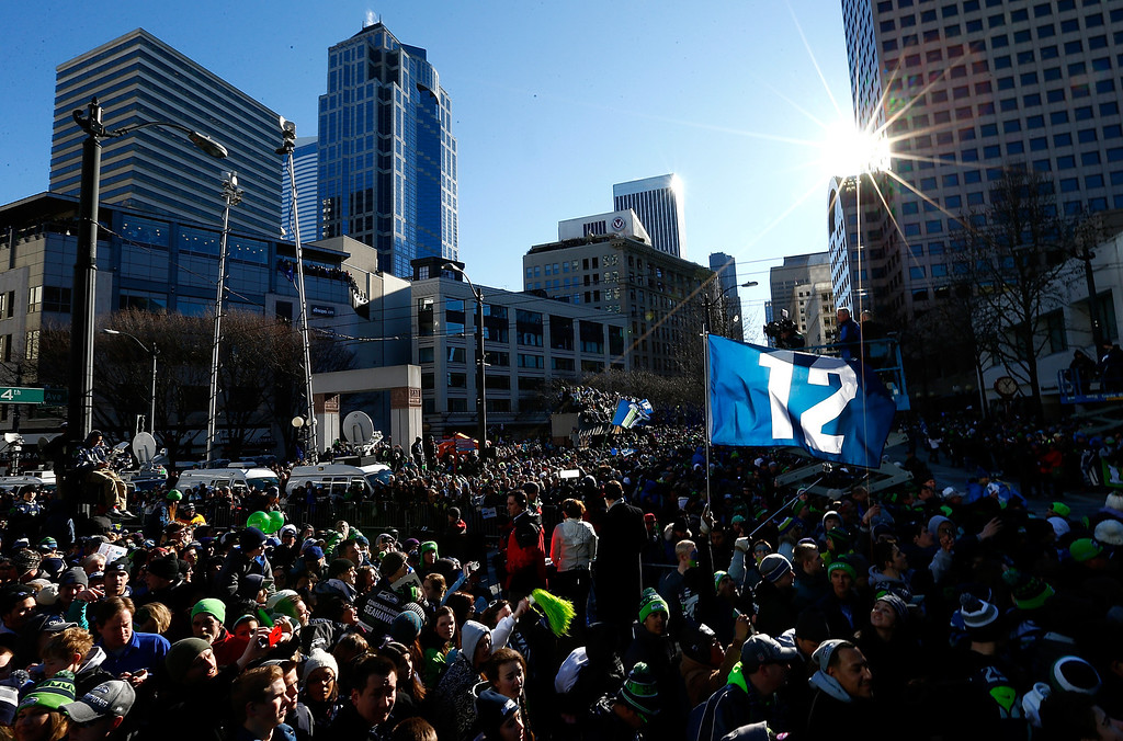 . Fans gather to watch the Seattle Seahawks celebrate their victory in Super Bowl XLVII during a parade on February 5, 2014 in Seattle, Washington.  (Photo by Jonathan Ferrey/Getty Images)