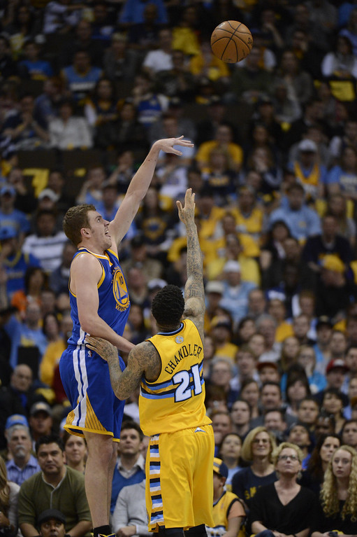 . DENVER, CO. - APRIL 20: Golden State Warriors power forward David Lee (10) takes a shot over Denver Nuggets shooting guard Wilson Chandler (21) in the second quarter. The Denver Nuggets took on the Golden State Warriors in Game 1 of the Western Conference First Round Series at the Pepsi Center in Denver, Colo. on April 20, 2013. (Photo by John Leyba/The Denver Post)