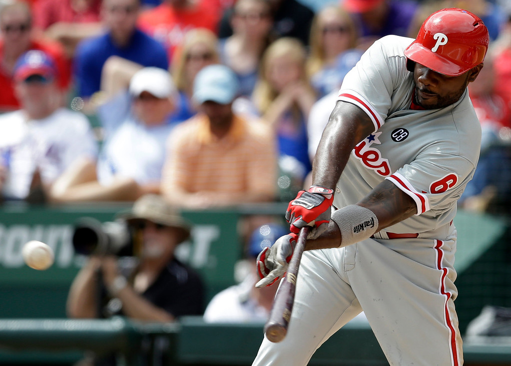 . Philadelphia Phillies\' Ryan Howard (6) singles against the Texas Rangers during the third inning of an opening day baseball game at Globe Life Park, Monday, March 31, 2014, in Arlington, Texas.  (AP Photo/Tony Gutierrez)