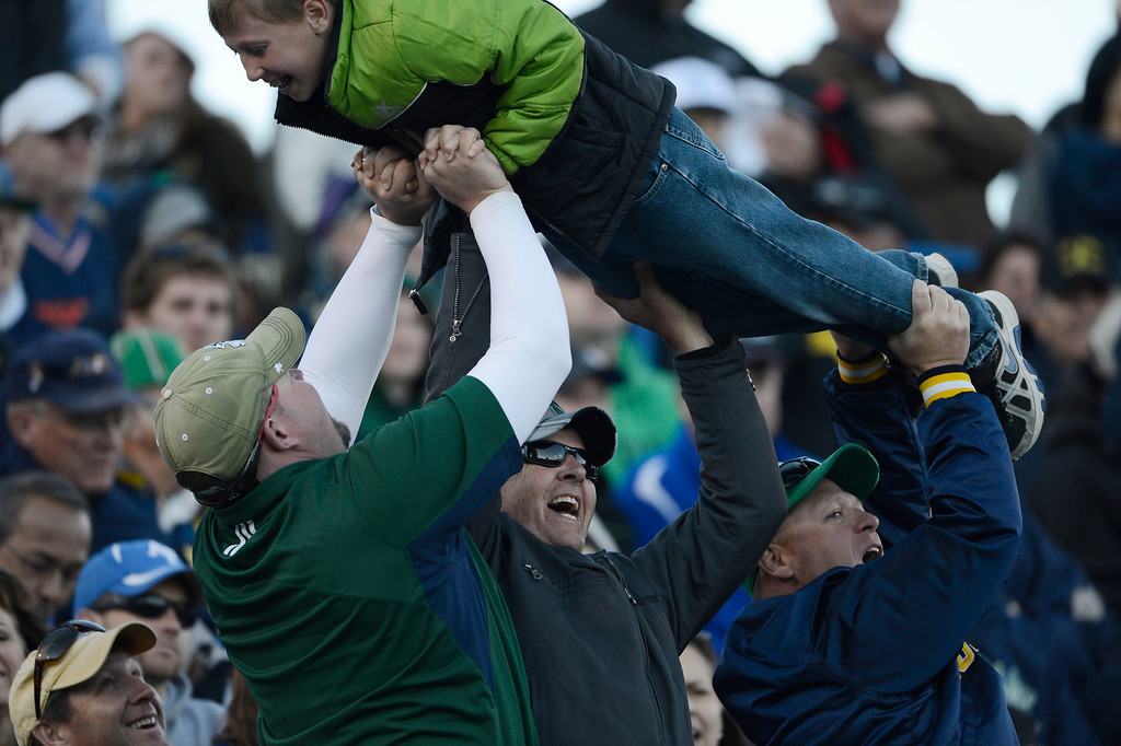 . COLORADO SPRINGS, CO - OCTOBER 26: Notre Dame fans celebrate Notre Dame WR, TJ Jones\' touchdown catch in the third quarter at Falcon Stadium, Saturday afternoon, October 26, 2013. (Photo By Andy Cross/The Denver Post)