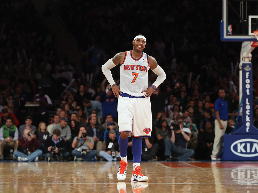 . Carmelo Anthony #7 of the New York Knicks reacts after taking a foul against the Denver Nuggets at Madison Square Garden on December 9, 2012 in New York City. The Knicks defeated the Nuggets 112-106. (Photo by Bruce Bennett/Getty Images)