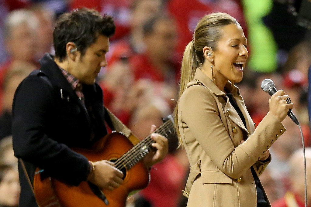 . ST LOUIS, MO - OCTOBER 26:  Colbie Caillat performs the national anthem duing pre-game ceremonies for Game Three of the 2013 World Series between the St. Louis Cardinals and the Boston Red Sox at Busch Stadium on October 26, 2013 in St Louis, Missouri.  (Photo by Ronald Martinez/Getty Images)