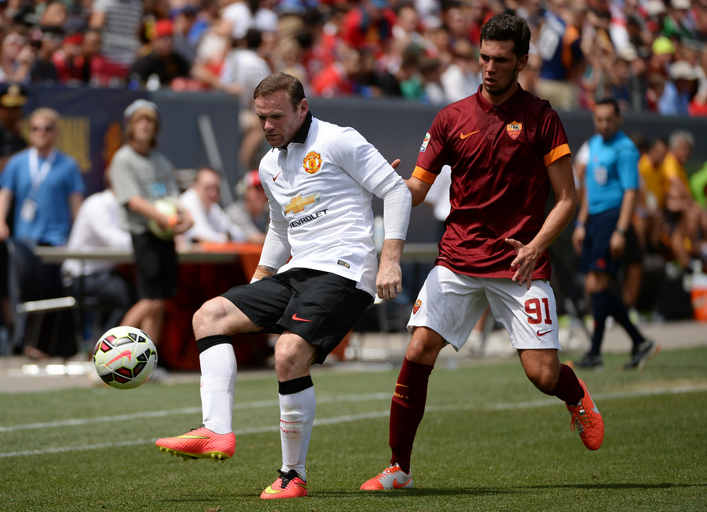 . Wayne Rooney of Manchester United (10), left, controls the ball against  Arturo Calabresi of AS Roma (91) during the game at Sports Authority Field at Mile High in Denver, Colorado,  July 26, 2014. (Photo by Hyoung Chang/The Denver Post)