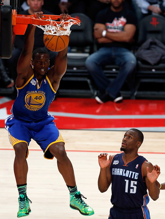 . HOUSTON, TX - FEBRUARY 15:  Harrison Barnes #44 of the Golden State Warriors and Team Shaq dunks the ball next to Kemba Walker #15 of the Charlotte Bobcats in the BBVA Rising Stars Challenge 2013 part of the 2013 NBA All-Star Weekend at the Toyota Center on February 15, 2013 in Houston, Texas.  (Photo by Scott Halleran/Getty Images)