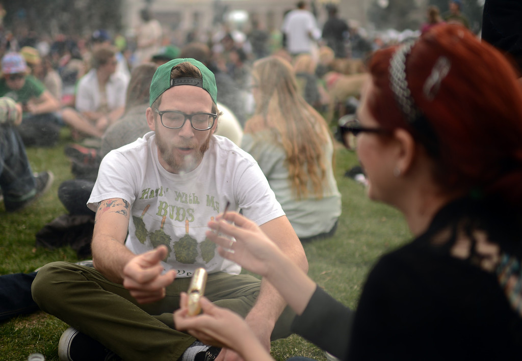 . DENVER, CO. - APRIL 20 : Nick, left, and Andrea and a crowd of marijuana smokers celebrate the counterculture holiday known as 4/20 on the first celebration since Colorado and Washington made pot legal for recreation use. (Photo By Hyoung Chang/The Denver Post)