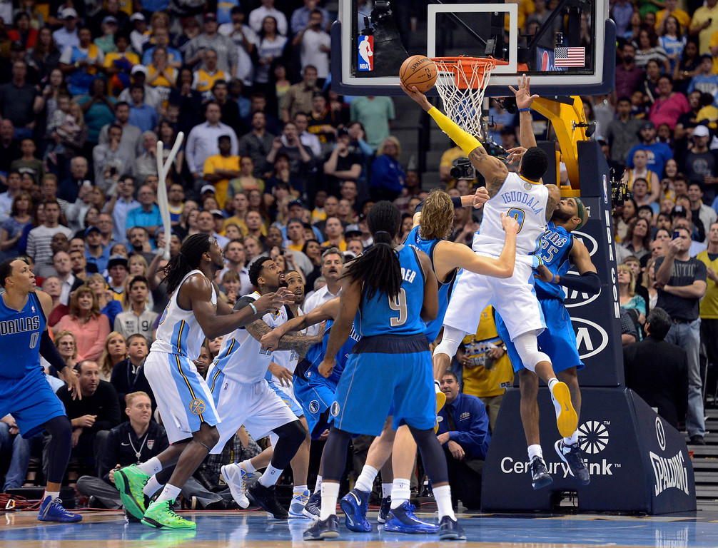 . DENVER, CO. - APRIL 04: Andre Iguodala (9) of the Denver Nuggets goes up for the winning shot on Vince Carter (25) of the Dallas Mavericks with 2.8 seconds in the game April 4,  2013 at Pepsi Center. (Photo By John Leyba/The Denver Post)