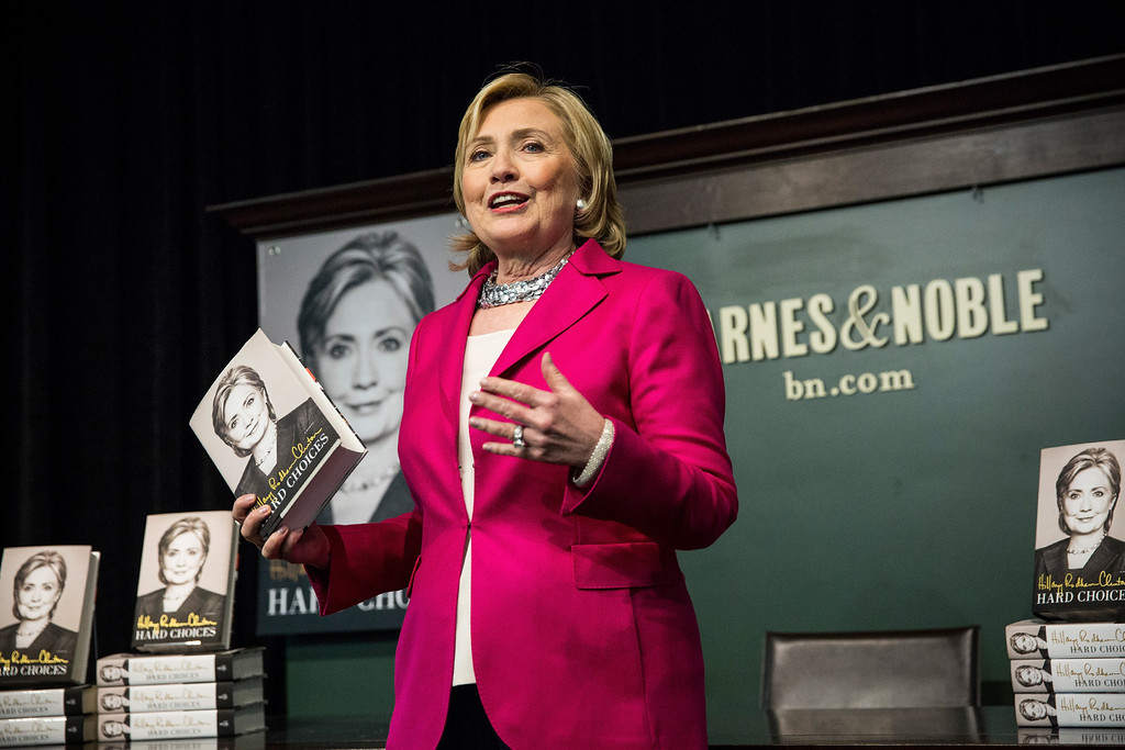""". Former Secretary of State Hillary Clinton speaks to a crowd during a book signing for her new book, \""""Hard Choices\"""" at a Barnes & Noble on June 10, 2014 in New York City. Clinton has published the book in what many believe is the beginning of another bid for the presidency.  (Photo by Andrew Burton/Getty Images)"""