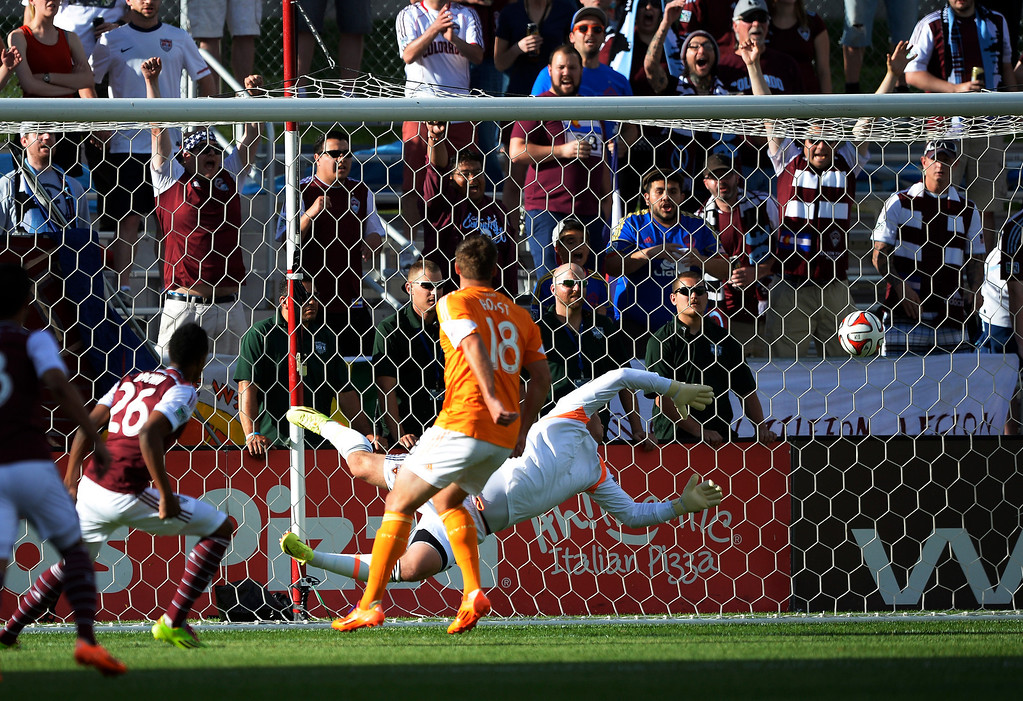. Colorado Rapids forward Deshorn Brown (26) watches his header go past Houston Dynamo goalkeeper Tally Hall (1) during the first half June 1, 2014 at Dick\'s Sporting Goods Park. (Photo by John Leyba/The Denver Post)