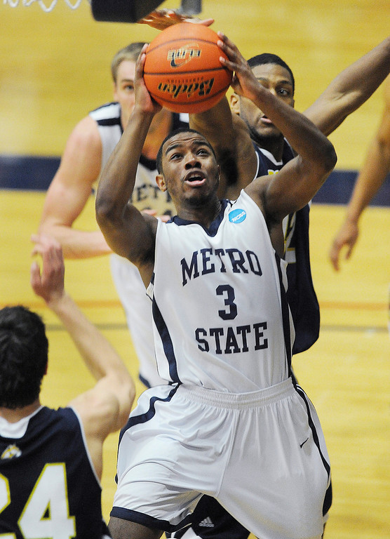 . DENVER, CO. - MARCH 5: Metro State\'s junior guard Brandon Jefferson (3) attracted a crowd under the hoop in the second half. The Metro State University of Denver men\'s basketball team defeated Colorado Christian University 87-75 Tuesday night, March 5, 2013. (Photo By Karl Gehring/The Denver Post)