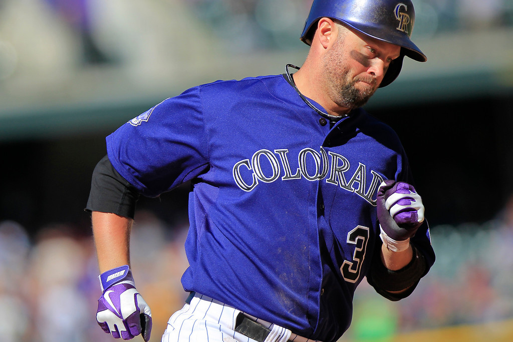 . Colorado Rockies\' Michael Cuddyer rounds the bases after hitting a two run homer, scoring Troy Tulowitzki, to tie the game at six during the seventh inning of the MLB National League baseball game against the Los Angeles Dodgers Saturday June 1, 2013 in Denver. (AP Photo/Barry Gutierrez)