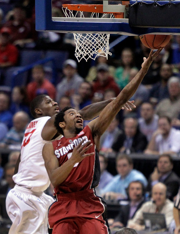 . Stanford\'s Chasson Randle, right, heads to the basket as New Mexico\'s Deshawn Delaney defends during the second half of a second-round game in the NCAA college basketball tournament Friday, March 21, 2014, in St. Louis. Stanford won 58-53. AP Photo/Jeff Roberson)